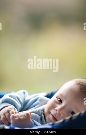 5 Months Old Eurasian Baby Boy In A Jumping Kids Toy Swing