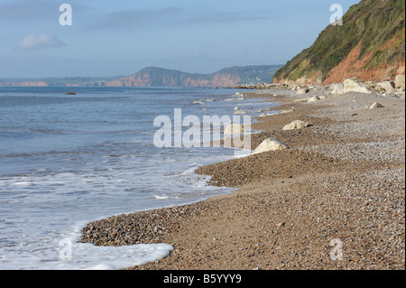 View along the pebble beach at Branscombe towards Sidmouth East Devon - Stock Photo