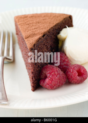 Chocolate Sponge with Whipped Cream and Raspberries - Stock Photo