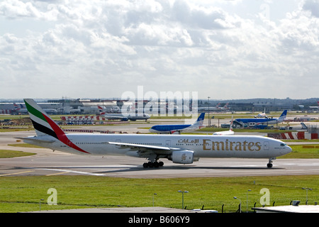 Emirates Boeing 777 airliner at the London Heathrow Airport England United Kingdom - Stock Photo