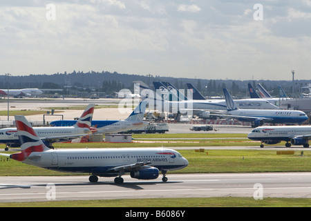 Airliners on the runway at London Heathrow Airport England United Kingdom - Stock Photo