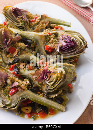 Roasted Globe Artichokes with Aubergine Peppers and Olives - Stock Photo