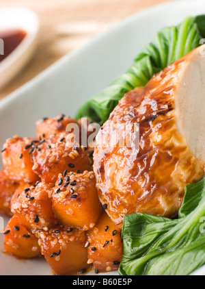 Soy Roasted Chicken on Steamed Pac Choi with Teriyaki Roasted butternut Squash - Stock Photo