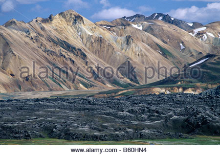 Colourful mountain landscape of Rhyolite with a view from the lava field of Laugah, Laugahraun, towards the Nordurbarmur - Stock Photo