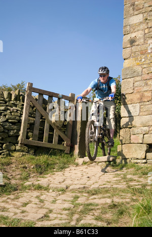 Mountain biking in the  Peak District National Park Derbyshire - Stock Photo