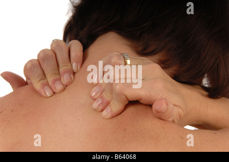 women with back and neck ache rubbing both shoulders isolated on white - Stockfoto