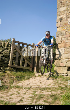 Mountain biking in the Peak District National Park Derbyshire visit tourist tourism - Stock Photo
