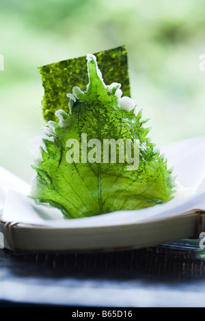 Shiso tempura served with nori, close-up - Stock Photo
