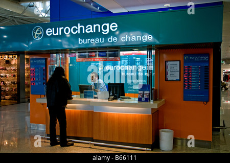 passenger at a bureau de change office operated by travelex at stock photo royalty free image. Black Bedroom Furniture Sets. Home Design Ideas