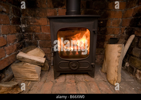 a small cast iron wood burning stove fire fireplace