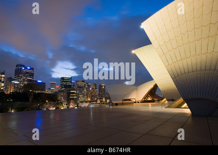 Sydney opera house and skyline at night - Stock Photo