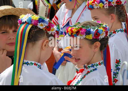 Ukrainian dancers in traditional cultural costumes - Stock Photo