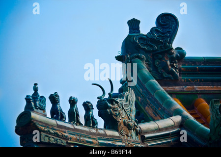Low angle view of sculpture on the roof of a building, Tower of Buddha Fragrance, Summer Palace, Beijing, China - Stock Photo