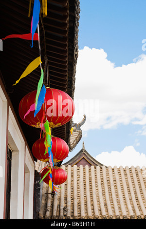Low angle view of Chinese lanterns hanging on a building, HohHot, Inner Mongolia, China - Stock Photo