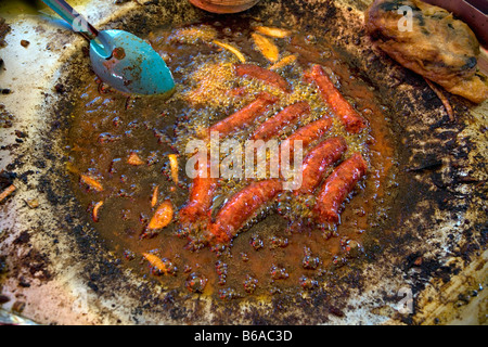 Mexico, Malinalco, Frying sausages - Stockfoto