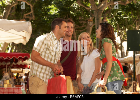 Group of friends shopping in market - Stock Photo