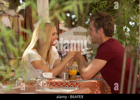 Couple in french market cafe - Stock Photo