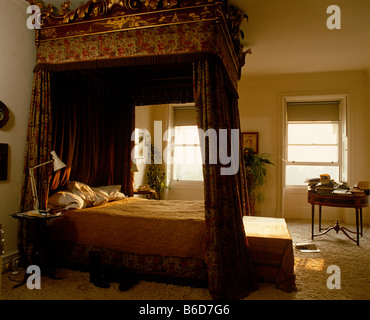 Four poster bed in luxurious bedroom in grand English house. - Stock Photo
