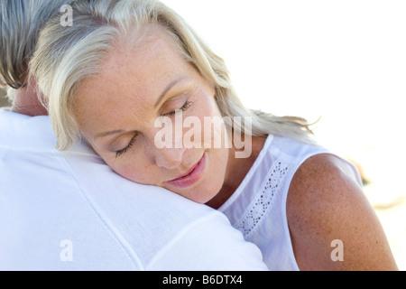 Senior couple embracing - Stock Photo