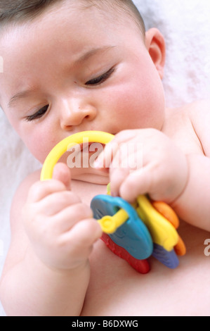 Baby boy. 6-month-old baby boy playing with a toy. - Stock Photo