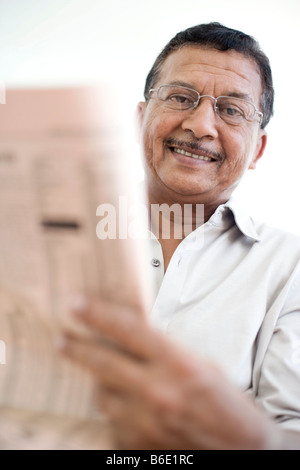Man reading a newspaper. - Stock Photo