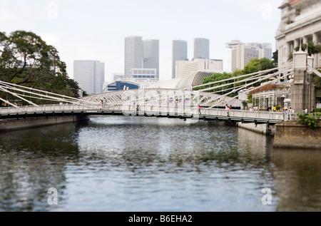 Cavenagh Bridge near Fullerton Hotel Singapore - Stock Photo