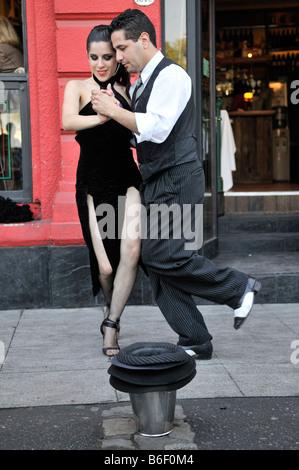 Tango dancers in the dock area La Boca, Buenos Aires, Argentina, South America - Stock Photo