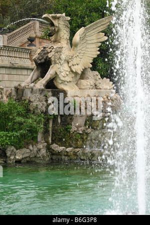 Ornamental Cascade Stone Statue of Dragon Griffin in Water Fountain In Parc De La Ciutadella, Old Town, Barcelona, - Stock Photo