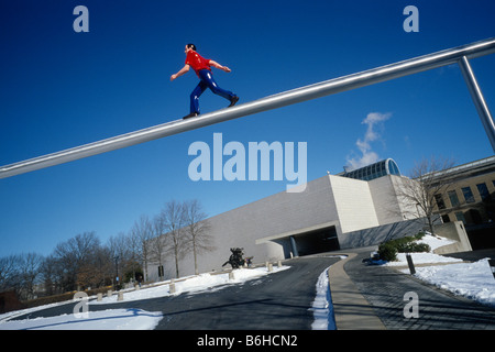 Boston. USA. West Wing of the Boston Museum of Fine Arts & Jonathan Borofsky's Walking Man sculpture. - Stock Photo