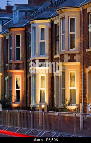 Terraced housing in a 1930s style on Belgrave Crescent opposite Ridley Park in Blyth, lit for the Blyth in New Light - Stockfoto