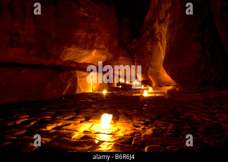 Romantic candle-lit view of the Siq leading to ancient Petra's famous Treasury (Al Khazneh). - Stock Photo