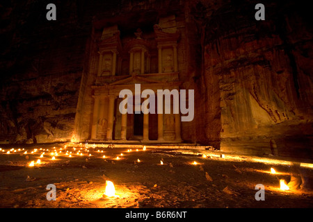 Romantic candle-lit view of Al Khazneh (Treasury) at Petra, one of the new wonders of the world, Jordan. - Stock Photo