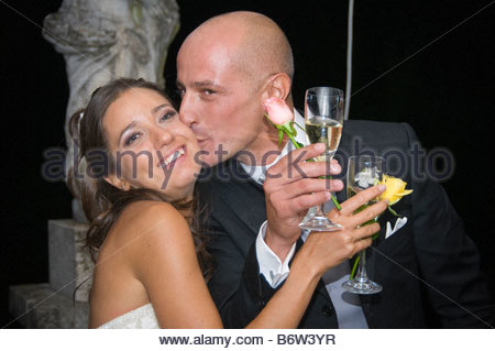 Bride and groom kissing at the toast. - Stock Photo