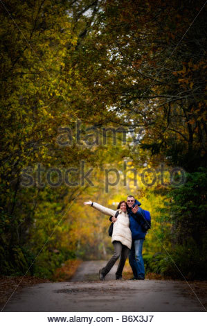 Happy couple on road - Stock Photo