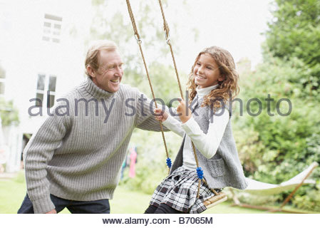 Girl 8 10 Swinging On Garden Rope Swing Smiling Side View