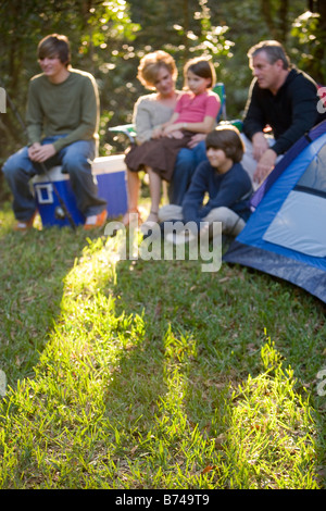 Portrait of family together on camping trip by tent - Stockfoto