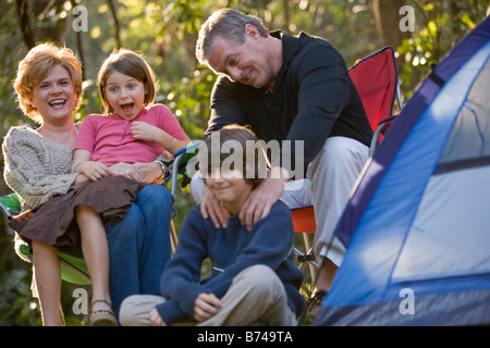 Portrait of family together on camping trip at campsite - Stockfoto