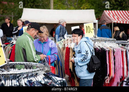 People buying clothes in Pestuumarkkinat market fair, Rautalampi, Finland - Stock Photo