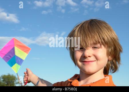 Six year old boy with kite, Winnipeg, Canada - Stock Photo