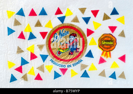Printed ephemera / Citrus fruit wrapper from Spain - dwarf / gnome illustration on tissue paper. - Stock Photo