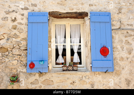 Window with blue shutters, Vaison-la-Romaine, Vaucluse, Provence-Alpes-Cote d'Azur, Southern France, Europe - Stock Photo