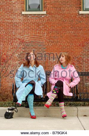 Woman In Socks Sitting On Floor Stockfoto Lizenzfreies