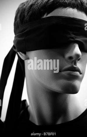Dummy in bandage on the eyes - Stock Photo