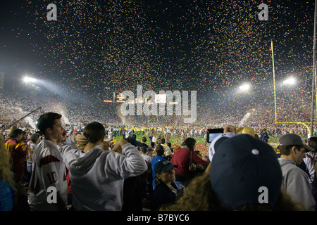 Colorful confetti falls on the crowd at the annual New Years Day Rose Bowl football game - Stock Photo