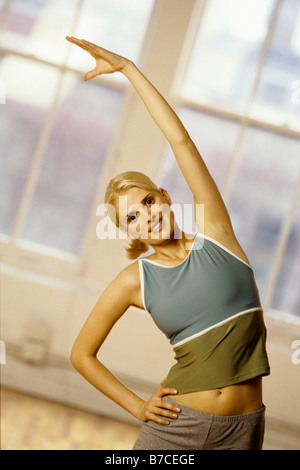 Young women stretching during exercise session - Stock Photo