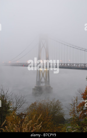 Mid-Hudson Bridge shrouded in fog. - Stock Photo