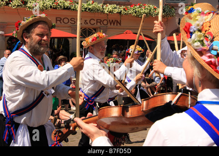 Morris men dancing with sticks outside the Rose and Crown pub at Warwick Folk Festival, Warwick, UK - Stock Photo