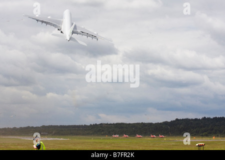 Airbus A380-800 taking off and kicking up a dust storm at Farnborough International Airshow 2008 UK - Stock Photo