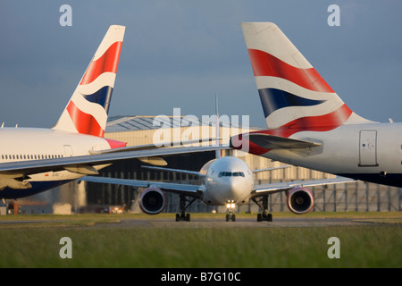 Tails of British Airways planes at London Heathrow airport. - Stock Photo
