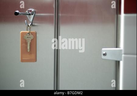 Mens Restroom Key Hanging on Coat Hook - Stock Photo